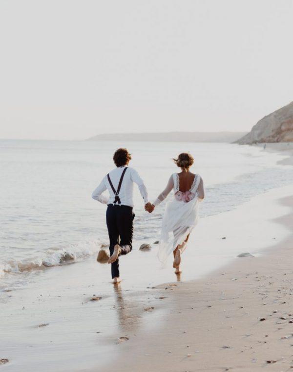 couple running on sand
